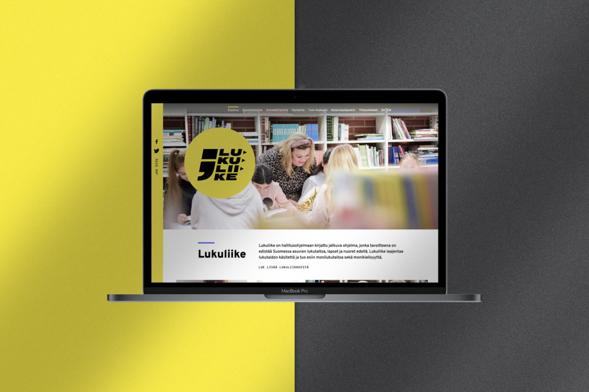 Lukuliike-verkkosivun näkymä MacBook Pro ruudulla keltamustalla taustalla.